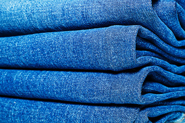 Jeans folded in the closet.