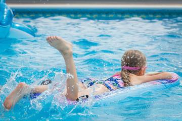 Girl on vacation having fun in the swimming pool