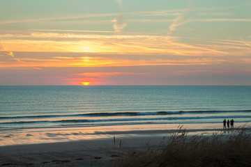 Sunset overlooking a beach in Normandy, on the West coast of Cotentin, France.