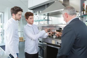 businessman talking to coffee staff