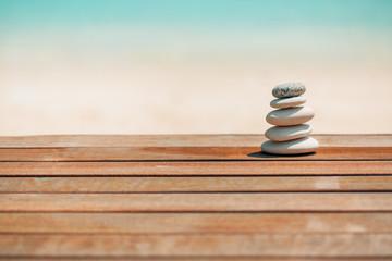 Foto op Plexiglas Stenen in het Zand Zen stones on relaxing beach background. Calmness and motivational background design