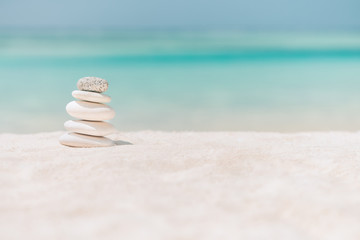 Zen stones on relaxing beach background. Calmness and motivational background design