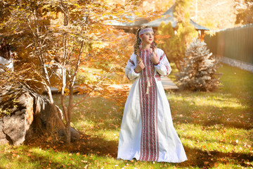 Girl in Russian folk costume .