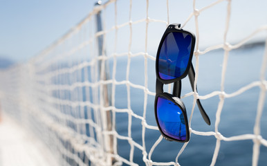 Picture of cool sunglasses hanging on net