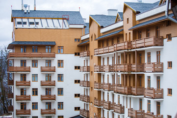 Picture of modern white building with wooden balconies