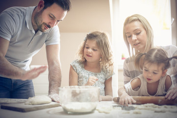Family making cookies in the kitchen.