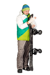 Full length portrait of young man in sportswear with snowboard isolated on a white background. Sport and people concept.