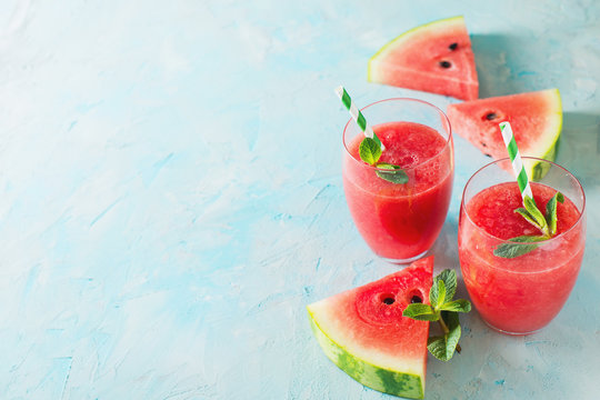 Watermelon smoothie with slice of fruit and leaf of mint