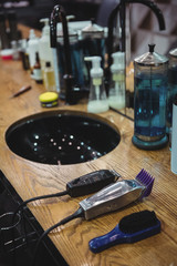 Various beauty products and barber tools on dressing table