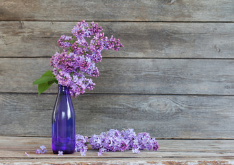 lilac on old wooden background