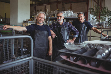 Portrait of smiling glassblowers