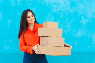 Woman with Many Cardboard Boxes Packages Received from Delivery Service