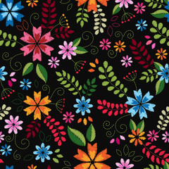 Embroidery seamless pattern texture wallpaper, background, with cute flowers and leaves. Vector floral ornament on black background. Template for design, printing, textiles, clothing