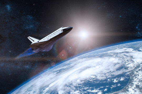 Blue planet Earth. Space shuttle taking off on a mission. Elements of this image furnished by NASA.