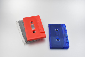Compact cassette stock images. Red and blue cassette tape. Compact Audio Cassette on a silver background