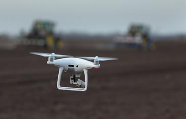 Drone flying above farmland