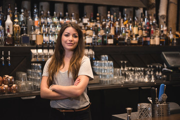 Female bartender at bar counter