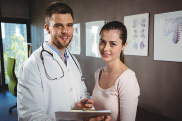 Portrait of physiotherapist and female patient