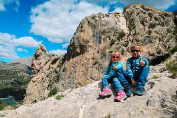 little boy and girl enjoy travel in mountains