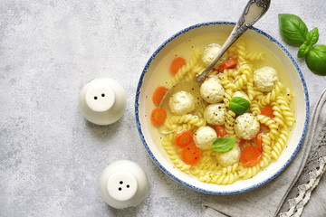 Soup with chicken meatballs and pasta,Top view.
