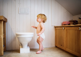 Cute toddler boy in the bathroom.