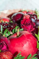 Bright red beautiful bouquet of fruits and flowers