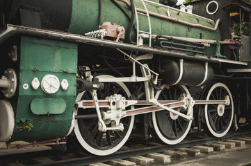 iron wheels of steam engine locomotive train on railway track, old and classic period train.