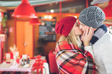Kissing young couple in cafe
