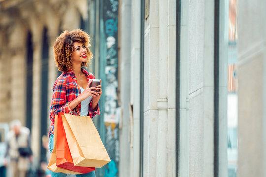 Young african american woman window shopping