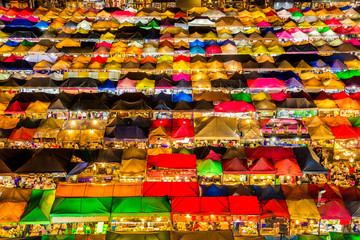 Many tent is colorful at night, abstract background. street food night market.