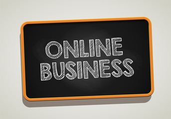 ONLINE BUSINESS written in chalkboard. Conceptual image with word ONLINE BUSINESS. Photo stock.