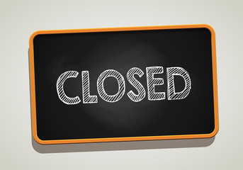 CLOSED written in chalkboard. Conceptual image with word CLOSED. Photo stock.
