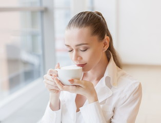 White blouse, cup coffee, happy