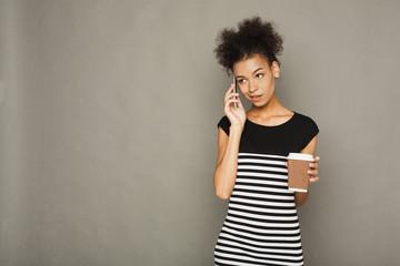 Serious beautiful woman talking on phone