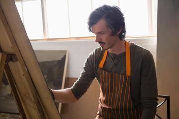 Man painting in art studio