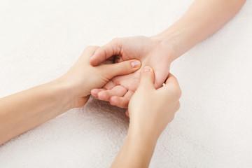 Hand massage closeup, acupressure