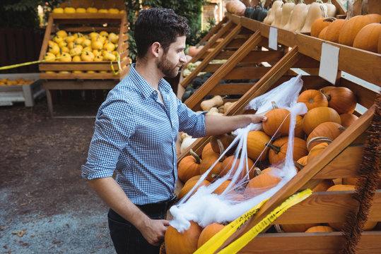 Man buying pumpkin