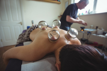 Man receiving cupping therapy