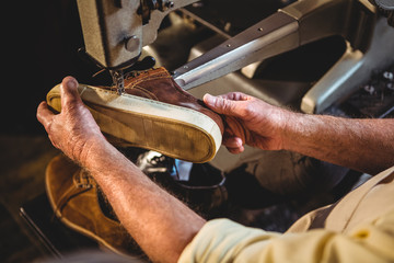 Shoemaker using sewing machine
