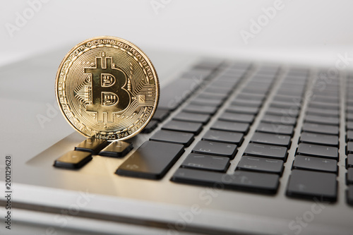 Golden Bitcoin New Virtual Money On Notebook A Visual Representation Of Digital Cryptocurrencies