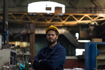 Portrait of confident technician standing with arms crossed