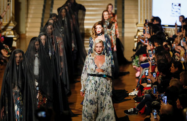 Models present creations by Kazakhstan's designer Sergei Shabunin during Kazakhstan Fashion Week in Almaty