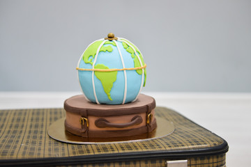 children's themed birthday travel. smash the cake. sweet globe on a suitcase