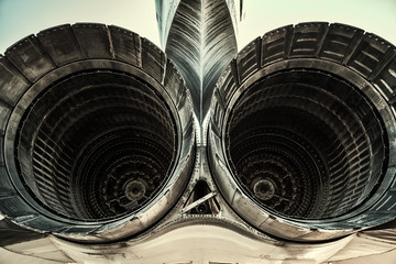 Two tail engines of jet. Back of airplane