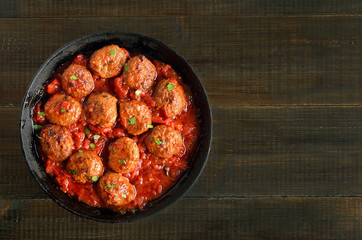 Meatballs with tomato sauce in frying pan