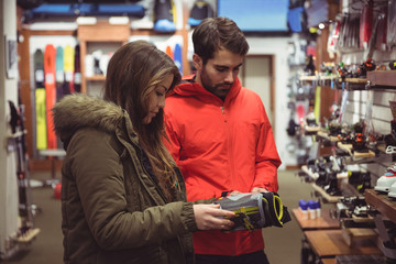 Couple selecting shoe in a shop