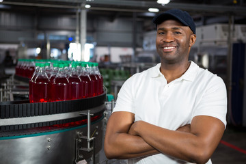 Portrait male worker standing in cold drink factory