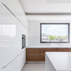 Contemporary white kitchen with island