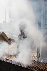 Man grilling kebab