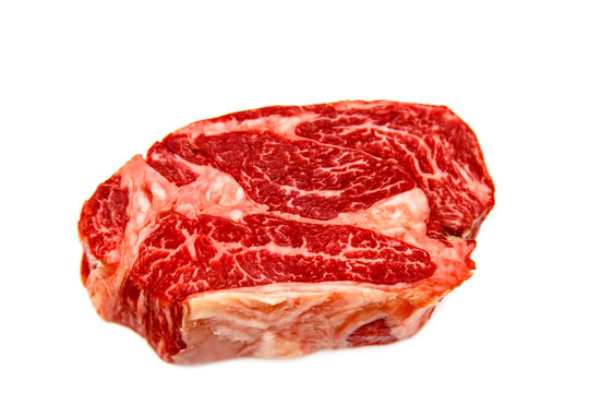 Raw marbled beef, Chuck roll steak on white background.